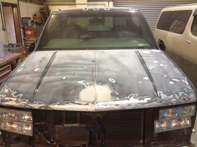 The hood on GMC dually ready for primer